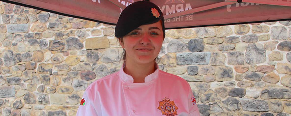 Camilla Olsen, proudly wearing her multi-terrain pattern uniform.
