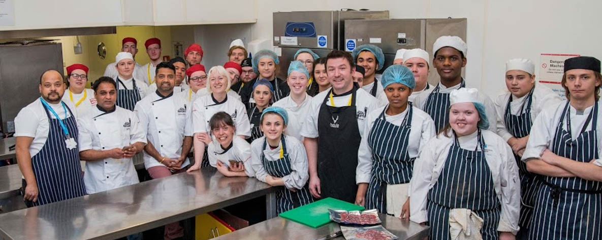 Group of young people with high-skilled chefs.