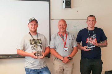 Staff holding awards