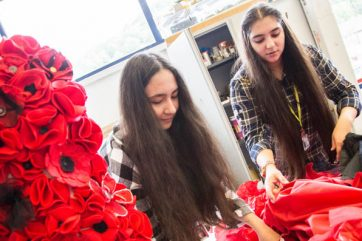 students designing poppy dress