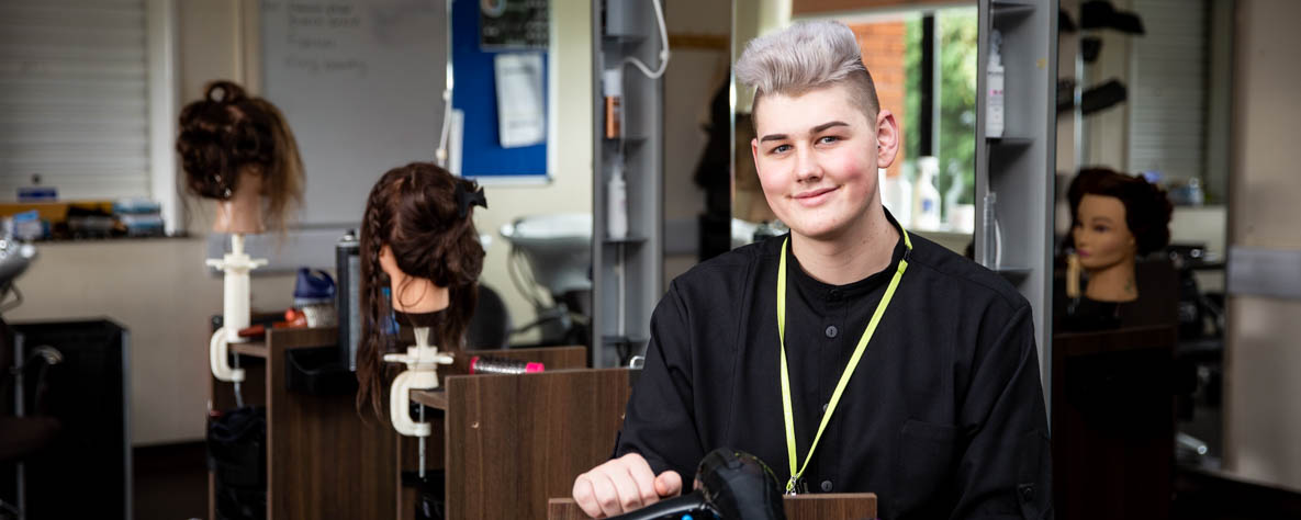 Hairdressing student in salon