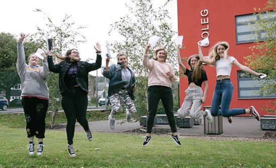 students celebrating outside campus