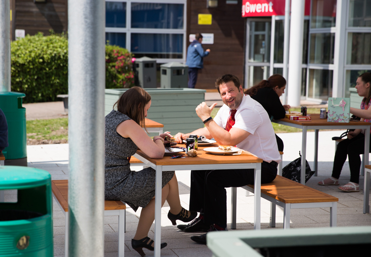 staff having lunch on outside sitting area