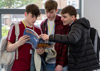 students looking at a book