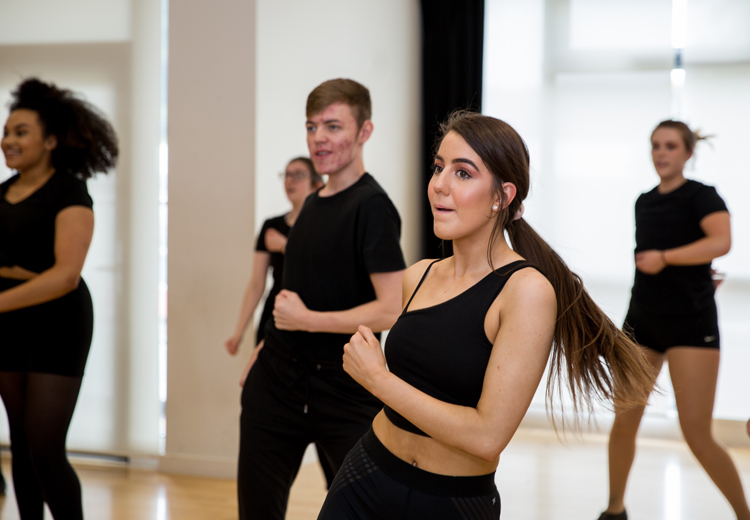 students dancing in rehearsal room