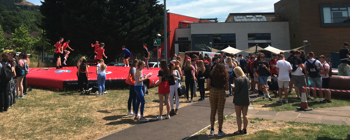 students outside college at event