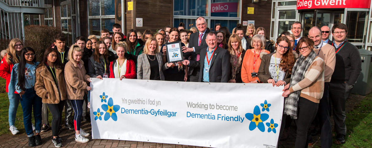 staff and students holding Dementia Banner