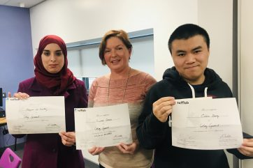 Three Coleg Gwent Students proudly showing their Tafflab honorary certificates.