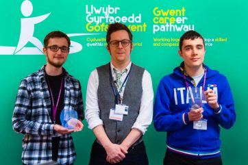 Two Coleg Gwentstudents, proudly showcasing their trophies.