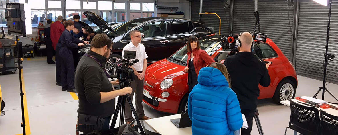 BBC X-Ray's Lucy Owen filming at Coleg Gwent's Automotive department