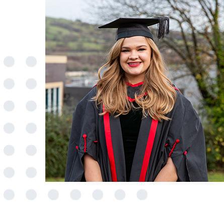 Learner in graduation gown