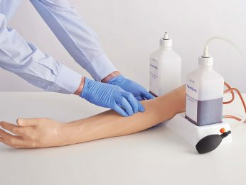 Injection puncture training arm with blood tubes