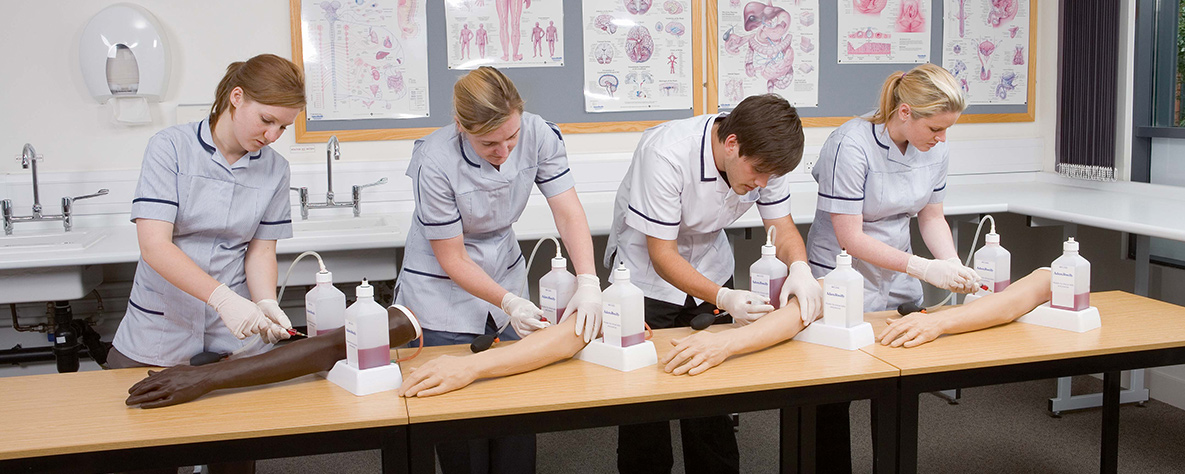 Healthcare learners using training arms