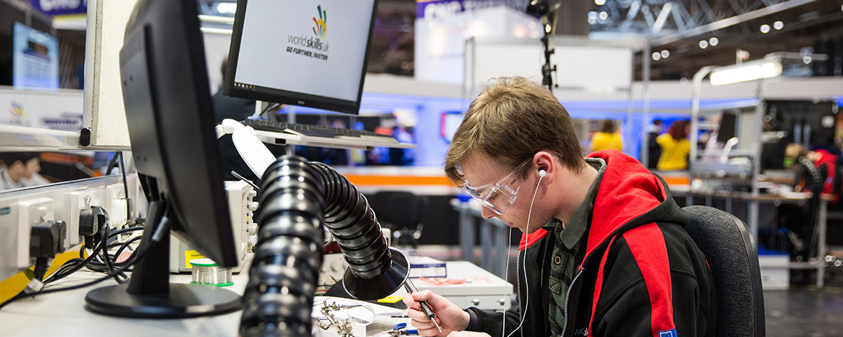WorldSkills learner soldering a circuit board