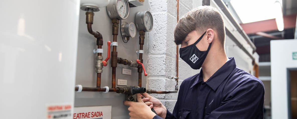 Ethan - Coleg Gwent plumbing student in mask