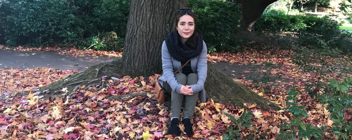 Melika Ghorbankhani sitting in a local park