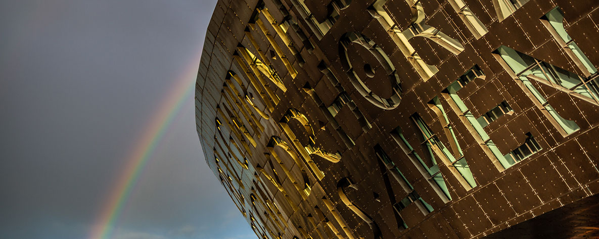 Millennium Centre building and rainbow