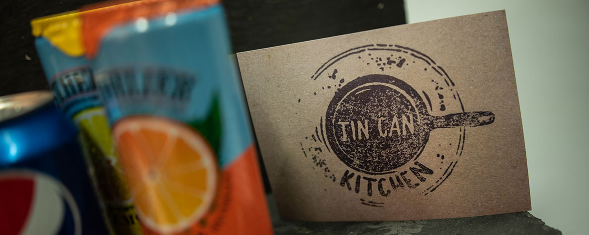 Tin Can Kitchen business card with cans
