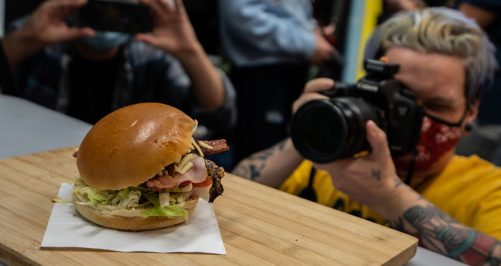 Photography learner taking photo of a burger