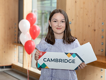 Alicia Powell holding a Cambridge sign