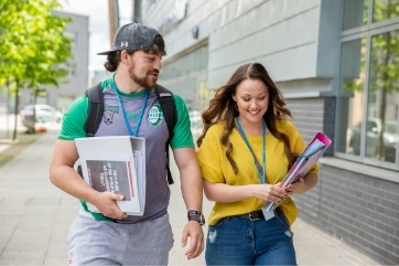 FE Myth Buster - students walking outside Coleg Gwent campus