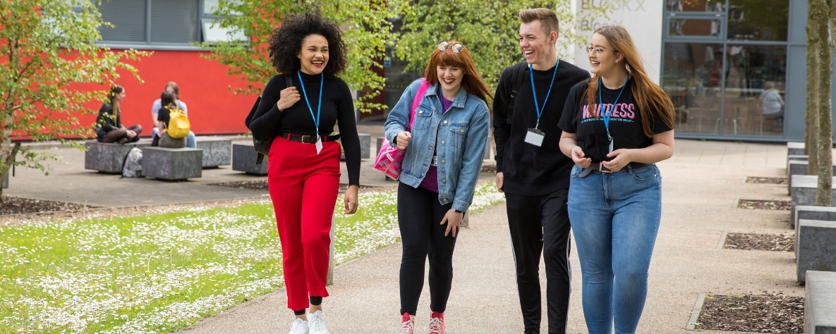 Students walking outside Coleg Gwent campus