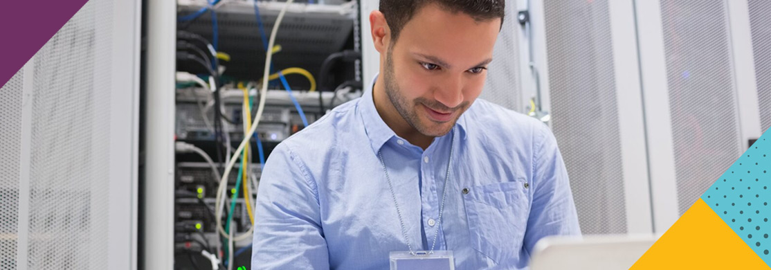 Man using laptop in network room