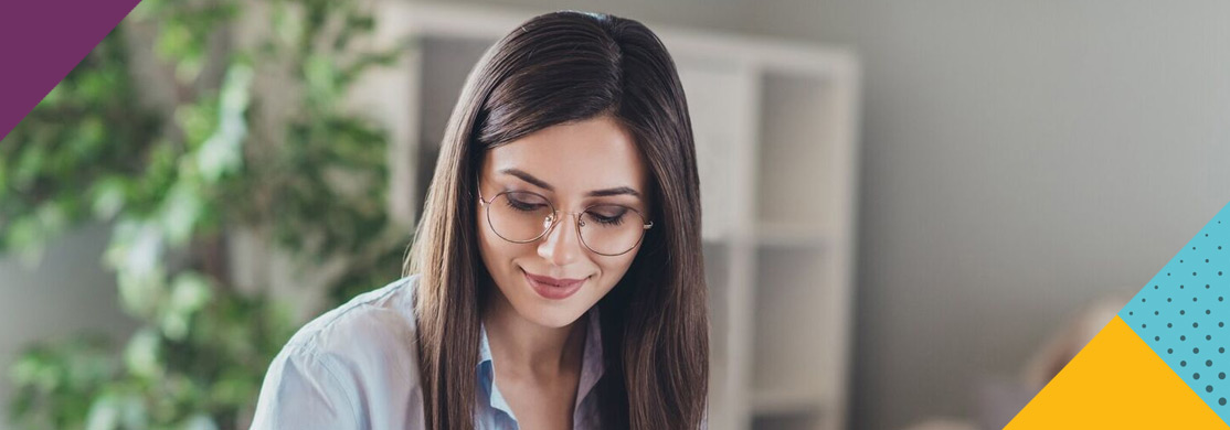 Woman in glasses in office