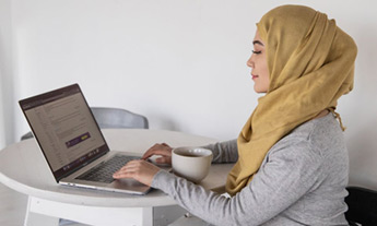 Woman in hijab on laptop
