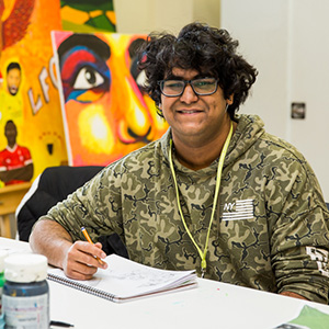 Learner Ayk Perera in art class