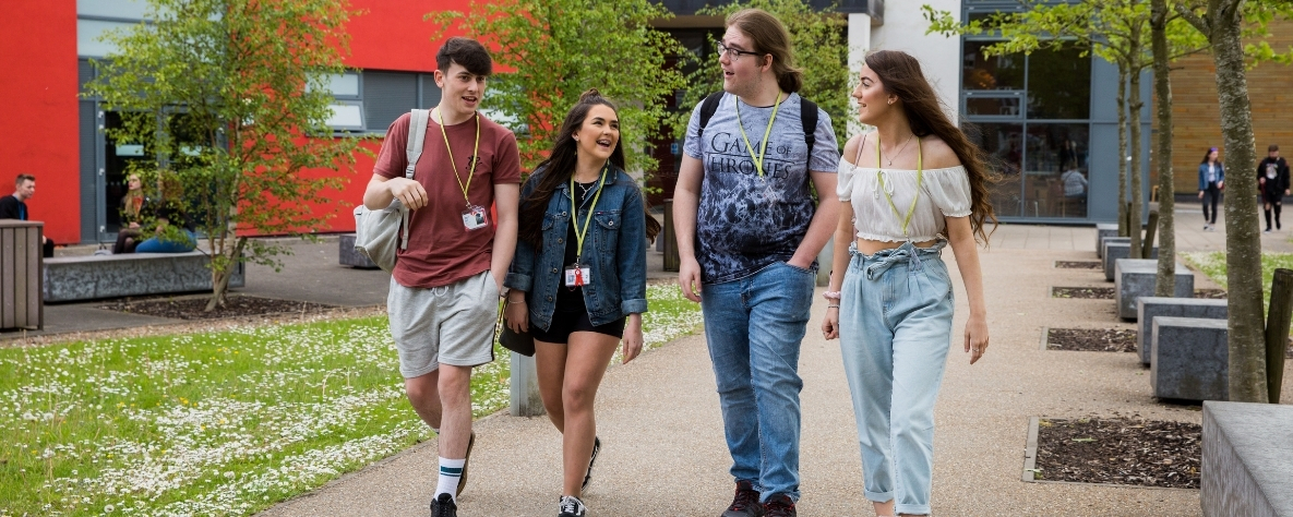 Starting college - Coleg Gwent learners walking outside Crosskeys campus