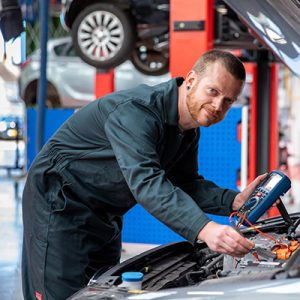 Kai Griffiths working on a car