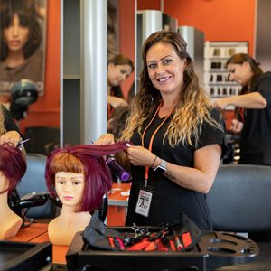 Vicki Holland working in a hair salon