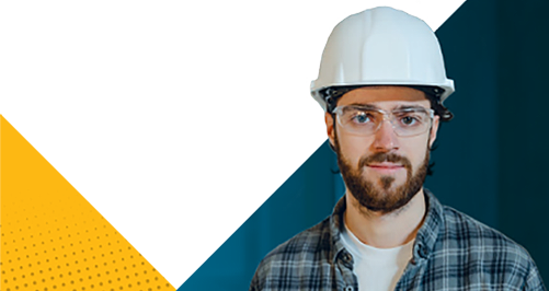 Man in hard hat and protective glasses
